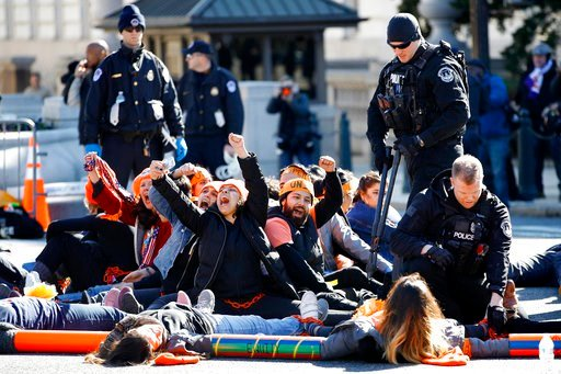 (AP Photo/Jacquelyn Martin, File). In this March 5, 2018, file photo, U.S. Capitol Police use bolt cutters to break chains locking together supporters of the Deferred Action for Childhood Arrivals (DACA) program.