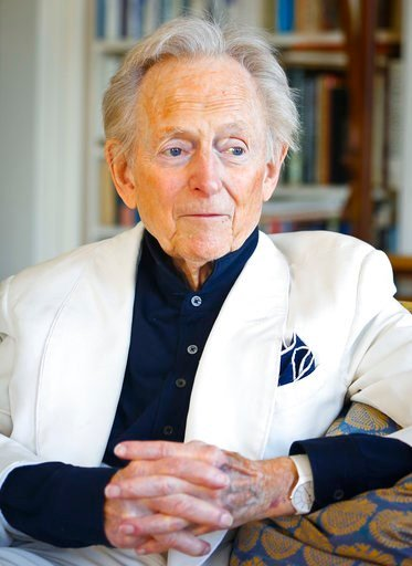 "(AP Photo/Bebeto Matthews, File).  In this July 26, 2016 file photo, American author and journalist Tom Wolfe, Jr. appears in his living room during an interview about his latest book, ""The Kingdom of Speech,"" in New York."