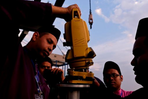 "(AP Photo/Sadiq Asyraf). Members of the Malaysian Islamic authority prepare for the process of ""Rukyah Hilal Ramadan,"" the sighting of the new moon to determine the start of the holy fasting month of Ramadan in Kuala Lumpur, Malaysia, Tuesday, May 15, ..."