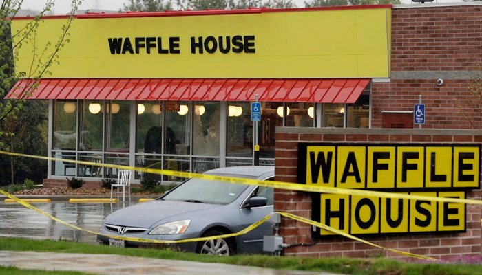 The gunman in the Waffle House shooting used firearms that had been taken from him by authorities and given to his father. (Source: AP Photo/Mark Humphrey)