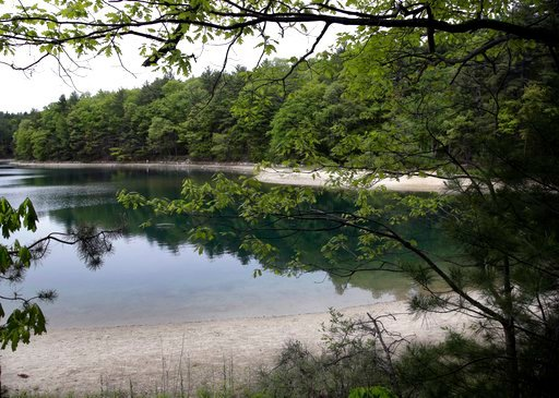 (AP Photo/Elise Amendola, File). FILE - This May 23, 2017, file photo shows a view of Walden Pond in Concord, Mass., where the 19th century American philosopher and naturalist Henry David Thoreau spent two years in solitude and reflection. A new Playst...