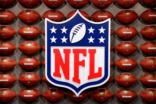 "(AP Photo/Seth Wenig, File). FILE - In this Nov. 30, 2017, file photo, an NFL logo is displayed at the opening of ""NFL Experience"" in Times Square, New York. Now that the U.S. Supreme Court has cleared the way for states to legalize sports betting, the..."