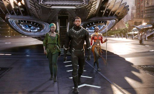 """(Matt Kennedy/Marvel Studios-Disney via AP). This image released by Disney shows Lupita Nyong'o, from left, and Chadwick Boseman and Danai Gurira in a scene from Marvel Studios' """"Black Panther."""" The global smash was nominated for a BET Award for best m..."""