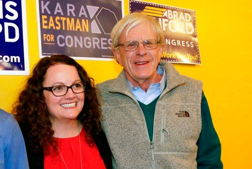 (AP Photo/Nati Harnik, File). FILE - In this April 5, 2018, photo, Kara Eastman and Brad Ashford, two Democrats vying to challenge 2nd District House incumbent Don Bacon, R-Neb., pose for a photo in Omaha, Neb. Democratic and independent voters will pi...