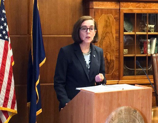 (AP Photo/Kristena Hansen, File). FILE - In this April 27, 2017, file photo, Oregon Gov. Kate Brown speaks in the Capitol ceremonial office in Salem, Ore. Oregon voters will choose candidates Tuesday, May 15, 2018, to compete in the state's general ele...