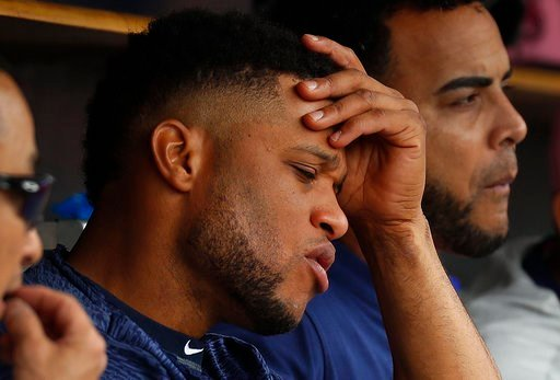 (AP Photo/Paul Sancya). In this  Sunday, May 13, 2018 photo, Seattle Mariners' Robinson Cano sits on the bench against the Detroit Tigers in the fifth inning of a baseball game in Detroit. Seattle Mariners All-Star second baseman Robinson Cano has been...