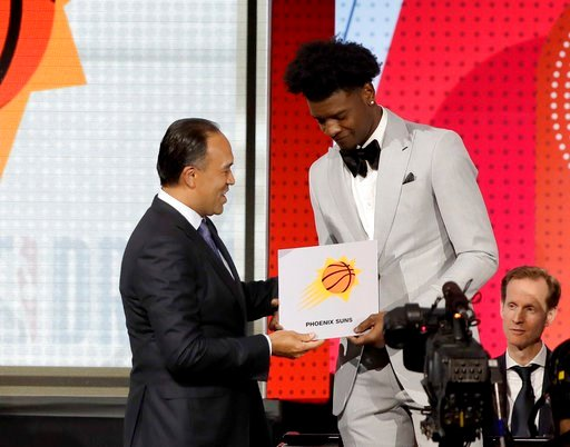 (AP Photo/Charles Rex Arbogast). NBA Deputy Commissioner Mark Tatum, left, congratulates Phoenix Suns forward Josh Jackson after Tatum announced that the Suns had won the first pick for the NBA basketball draft, during the draft lottery Tuesday, May 15...