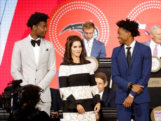 (AP Photo/Charles Rex Arbogast). Josh Jackson, left, representing the Phoenix Suns, Jami Gertz, center, representing the Atlanta Hawks, and De'Aaron Fox, representing the Sacramento Kings, wait for the announcement of the top three picks in the 2018 NB...