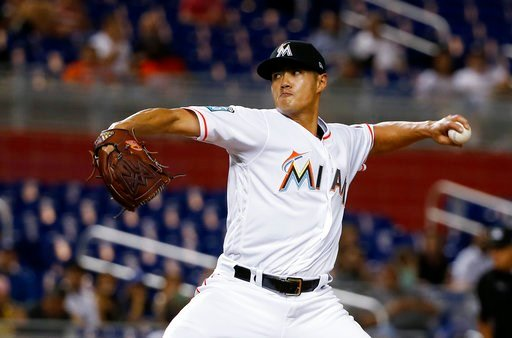 (AP Photo/Wilfredo Lee). Miami Marlins' Wei-Yin Chen, of Taiwan, winds up during the first inning of the team's baseball game against the Los Angeles Dodgers, Tuesday, May 15, 2018, in Miami.