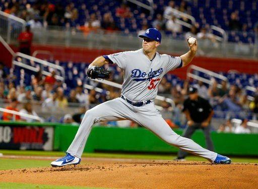 (AP Photo/Wilfredo Lee). Los Angeles Dodgers' Alex Wood delivers a pitch during the first inning of the team's baseball game against the Miami Marlins, Tuesday, May 15, 2018, in Miami.