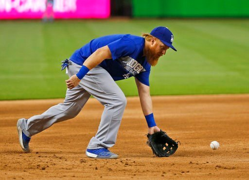 (AP Photo/Wilfredo Lee). Los Angeles Dodgers' Justin Turner warms up before the start of a baseball game against the Miami Marlins, Tuesday, May 15, 2018, in Miami. The slumping Dodgers have activated third baseman Turner and second baseman Logan Forsy...