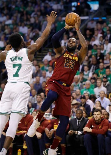 (AP Photo/Charles Krupa). Cleveland Cavaliers forward LeBron James, right, shoots against Boston Celtics guard Jaylen Brown during the first half in Game 2 of the NBA basketball Eastern Conference finals, Tuesday, May 15, 2018, in Boston.
