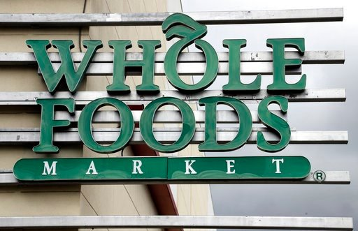 (AP Photo/Chris O'Meara, File). FILE - In this Monday, Aug. 28, 2017, file photo, a sign at a Whole Foods Market greets shoppers in Tampa, Fla. Amazon is bringing its Prime membership to Whole Foods, giving members special discounts and deals at the or...