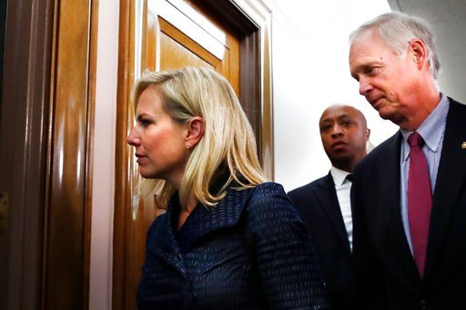 (AP Photo/Jacquelyn Martin). Homeland Security Secretary Kirstjen Nielsen, left, walks with Senate Homeland Security Committee Chair Sen. Ron Johnson, R-Wis., to a committee hearing of the Senate Homeland Security Committee, Tuesday, May 15, 2018.