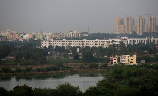 (AP Photo/Aijaz Rahi). In this May 2, 2018 photo, residential buildings are seen around Jakkur lake in Bangalore, India. India's Silicon Valley is bracing for yet another thirsty summer. Faucets are running dry and the lakes that once nurtured the sout...