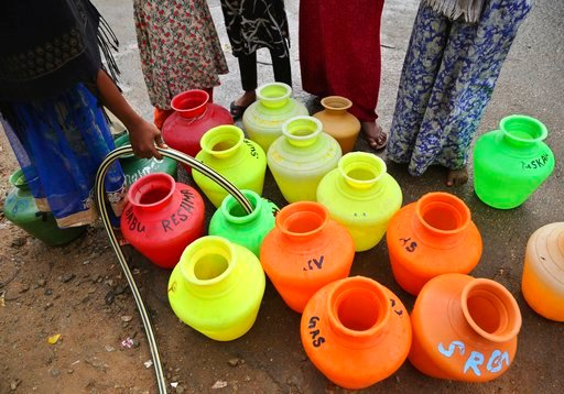 (AP Photo/Aijaz Rahi). In this May 1, 2018 photo, women collect water at a public tap in a poor residential neighborhood in Bangalore, India. India's Silicon Valley is bracing for yet another thirsty summer. Faucets are running dry and the lakes that o...