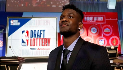 (AP Photo/Charles Rex Arbogast). Arizona's DeAndre Ayton poses for a portrait before the NBA basketball draft lottery Tuesday, May 15, 2018, in Chicago.