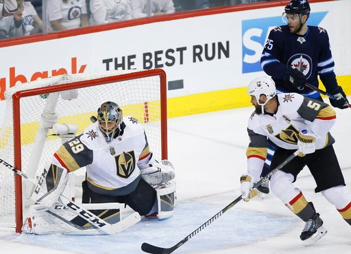 (John Woods/The Canadian Press via AP). Winnipeg Jets' Patrik Laine, not seen, scores on Vegas Golden Knights goaltender Marc-Andre Fleury (29) as Jets' Paul Stastny and Golden Knights' Deryk Engelland watch during the first period of Game 1 of the NHL...