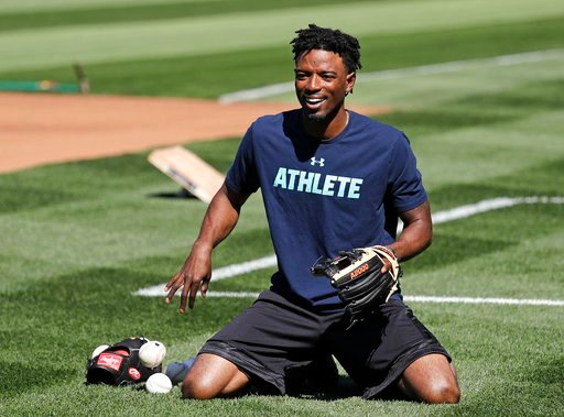 (AP Photo/Elaine Thompson). Seattle Mariners center fielder Dee Gordon smiles as he goes through a drill before the team's baseball game against the Texas Rangers Tuesday, May 15, 2018, in Seattle. Gordon could fill in at second base while Robinson Can...