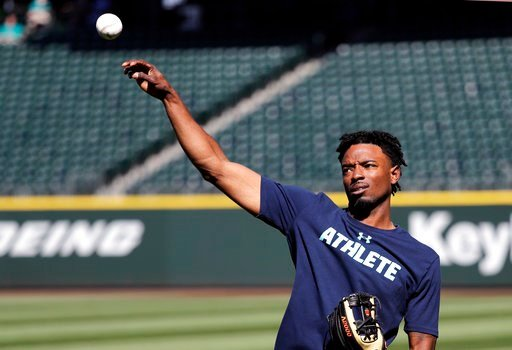 (AP Photo/Elaine Thompson). Seattle Mariners center fielder Dee Gordon tosses a ball before the team's baseball game against the Texas Rangers on Tuesday, May 15, 2018, in Seattle. Gordon could fill in at second base while Robinson Cano is out for 80 g...