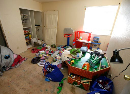 (AP Photo/Rich Pedroncelli). Toys and other items are strewn around one of the rooms of a home, Monday, May 14, 2018, where authorities removed 10 children and arrested their parents in Fairfield, Calif.