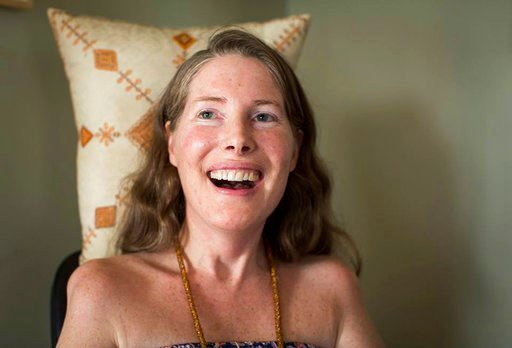"""(Niels Alpert via AP, File). FILE - In this Sunday, July 24, 2016, file photo provided by Niels Alpert, Betsy Davis smiles during her """"Right To Die Party"""" in Ojai, Calif. Davis threw herself the party as she became one of the first to use a California ..."""