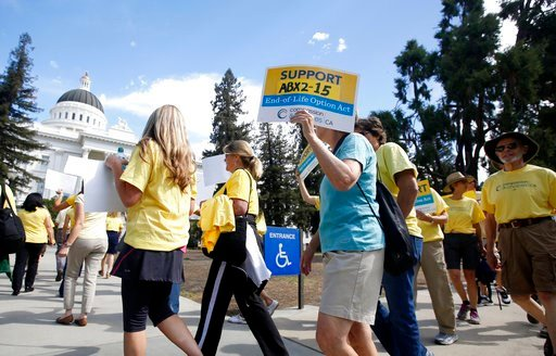 (AP Photo/Rich Pedroncelli, File). File - In this Sept. 24, 2015 file photo, supporters of a measure to allow the terminally ill to end their own life march at the Capitol while calling on California Gov. Jerry Brown to sign the bill in Sacramento, Cal...