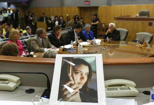 (AP Photo/Rich Pedroncelli, File). FILE - In this March 25, 2015, file photo, a portrait of Brittany Maynard sits on the dais of the Senate Health Committee as lawmakers heard testimony on proposed legislation allowing doctors to prescribe life-ending ...