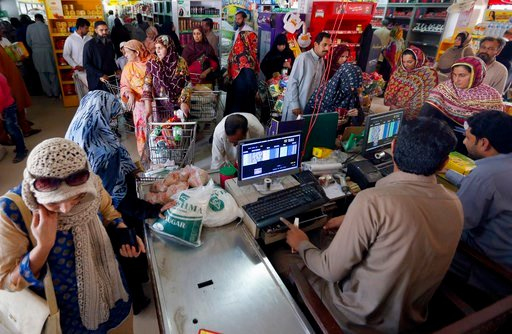 (AP Photo/Anjum Naveed). People wait in line to pay for specially-priced foodstuff for the upcoming Muslim month of Ramadan, at a government-run supermarket in Islamabad, Pakistan, Wednesday, May 16, 2018. Muslims across the world will be observing the...