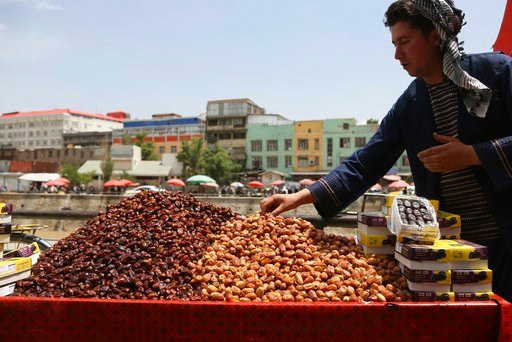 (AP Photo/Rahmat Gul). A street vendor sells dates ahead of the upcoming holy fasting month of Ramadan in Kabul, Afghanistan, Wednesday, May 16, 2018. Muslims across the world are observing the holy fasting month of Ramadan, when they refrain from eati...