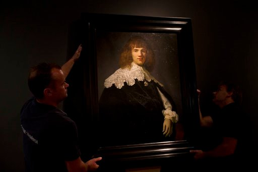(AP Photo/Peter Dejong). A painting attributed to famous Dutch Master Rembrandt is put on display at the Hermitage museum in Amsterdam, Netherlands, Wednesday, May 16, 2018. The unsigned painting which will be sold by gallery owner Jan Six, after being...
