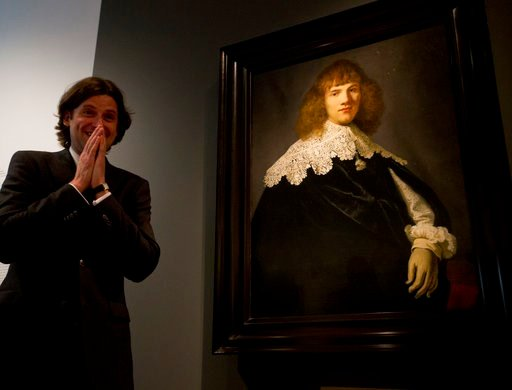 (AP Photo/Peter Dejong). Art dealer Jan Six reacts as a painting attributed to famous Dutch Master Rembrandt is put on display at the Hermitage museum in Amsterdam, Netherlands, Wednesday, May 16, 2018. The unsigned painting which will be sold by galle...