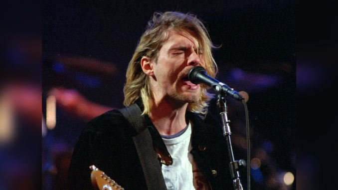 This Dec. 13, 1993, file photo shows Kurt Cobain of the band Nirvana performing in Seattle. (AP Photo/Robert Sorbo, File)