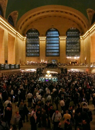 (AP Photo/Donald King). Commuters are stranded during the evening commute at Grand Central Terminal in New York on Tuesday, May 15, 2018. The Metro-North commuter railroad said Tuesday evening that downed trees across the tracks had caused it to suspen...