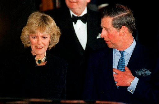 (AP Photo/Alastair Grant, File). FILE - In this Thursday, Jan. 28, 1999 file photo, Britain's Prince Charles and his companion Camilla Parker Bowles leave the Ritz Hotel in London, the first time that the couple, who have been friends for more than 25 ...