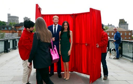 (AP Photo/Alastair Grant). Waxwork figure of Britain's Prince Harry and Meghan Markle are revealed for a media opportunity against the backdrop of Windsor Castle, in Windsor, England, Wednesday, May 16, 2018. Preparations continue in Windsor ahead of t...