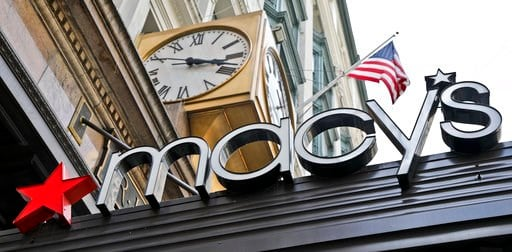 (AP Photo/Bebeto Matthews, File). FILE- This May 2, 2017, file photo shows corporate signage at Macy's flagship store in Manhattan, in New York. Macy's Inc. reports earnings Wednesday, May 16, 2018.