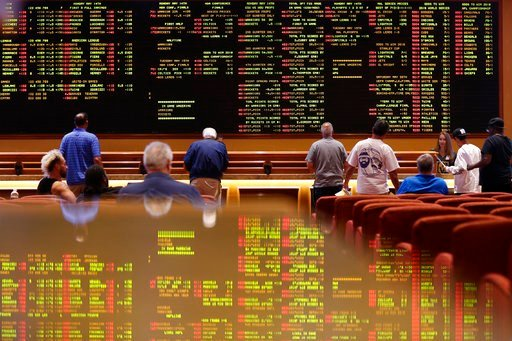 (AP Photo/John Locher). People line up to place bets in the sports book at the South Point hotel-casino, Monday, May 14, 2018, in Las Vegas. The Supreme Court on Monday gave its go-ahead for states to allow gambling on sports across the nation, strikin...
