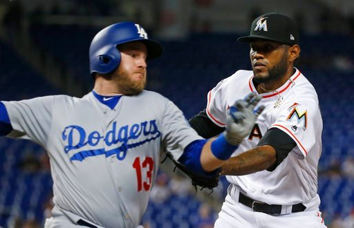 (AP Photo/Wilfredo Lee). Miami Marlins relief pitcher Tayron Guerrero, right, tags out Los Angeles Dodgers' Max Muncy as he heads for first base during the seventh inning of a baseball game Tuesday, May 15, 2018, in Miami. The Marlins defeated the Dodg...
