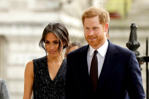 (AP Photo/Matt Dunham, file). FILE - In this Monday, April 23, 2018 file photo, Britain's Prince Harry and his fiancee Meghan Markle arrive to attend a Memorial Service to commemorate the 25th anniversary of the murder of black teenager Stephen Lawrenc...