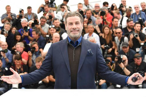 (Photo by Arthur Mola/Invision/AP). Actor John Travolta poses for photographers during a photo call for the film 'Gotti' at the 71st international film festival, Cannes, southern France, Tuesday, May 15, 2018.