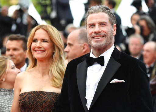 (Photo by Arthur Mola/Invision/AP). Actors Kelly Preston, left, and John Travolta from the film 'Gotti' pose for photographers upon arrival at the premiere of the film 'Solo: A Star Wars Story' at the 71st international film festival, Cannes, southern ...