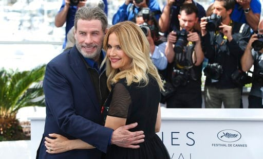 (Photo by Joel C Ryan/Invision/AP). Actors John Travolta, left, and Kelly Preston pose for photographers during a photo call for the film 'Gotti' at the 71st international film festival, Cannes, southern France, Tuesday, May 15, 2018.