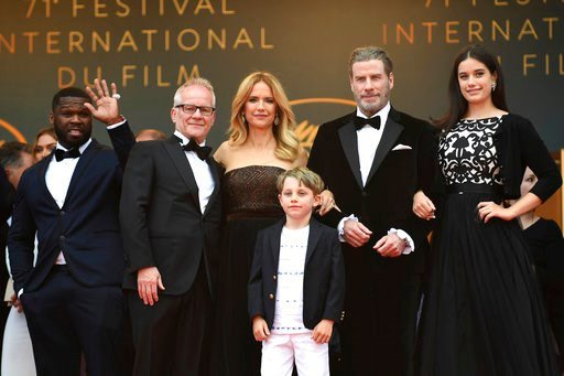 (Photo by Arthur Mola/Invision/AP). Actress Kelly Preston, center left, and actor John Travolta, center right, from the film 'Gotti' pose with singer Curtis '50 Cent' Jackson, from left, Cannes Film Festival Director Thierry Fremaux, Benjamin Travolta,...