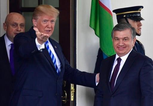 (AP Photo/Susan Walsh). President Donald Trump greets Uzbek President Shavkat Mirziyoyev outside the West Wing of the White House in Washington, Wednesday, May 16, 2018.