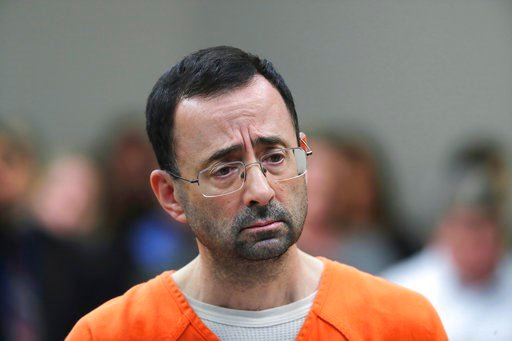 (AP Photo/Paul Sancya, File). FILE - In this Nov. 22, 2017, file photo, Dr. Larry Nassar appears in court for a plea hearing in Lansing, Mich. Michigan State University has reached a $500 million settlement with hundreds of women and girls who say they...