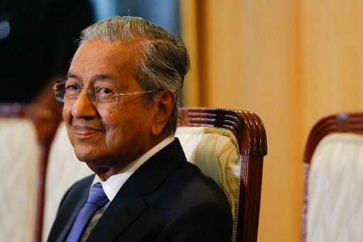 (AP Photo/Vincent Thian). Malaysian Prime Minister Mahathir Mohamad smiles during press conference in Putrajaya, Malaysia on Wednesday, May 16, 2018. New Prime Minister Mahathir Mohamad says Malaysia will seek to retrieve billions of dollars believed t...