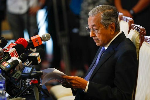 (AP Photo/Vincent Thian). Malaysian Prime Minister Mahathir Mohamad reads a note during a press conference in Putrajaya, Malaysia on Wednesday, May 16, 2018. Mahathir says Malaysia will seek to retrieve billions of dollars believed to have been launder...