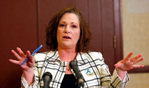 (AP Photo/Rick Bowmer,File). FILE - In this April 5, 2018 file photo McKenna Denson speaks with reporters during a news conference in Salt Lake City. The Mormon church has asked a judge to toss out a lawsuit accusing leaders of brushing aside rape alle...