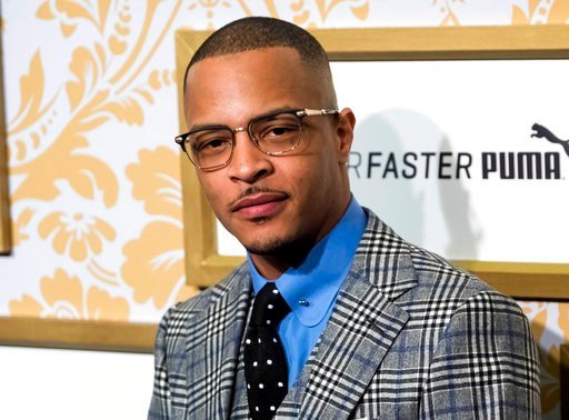 (Photo by Charles Sykes/Invision/AP, File). FILE - In this Jan. 27, 2018 file photo, T.I. attends the Roc Nation pre-Grammy brunch in New York. Police say rapper T.I. has been arrested for disorderly conduct and public drunkenness as he tried to enter ...